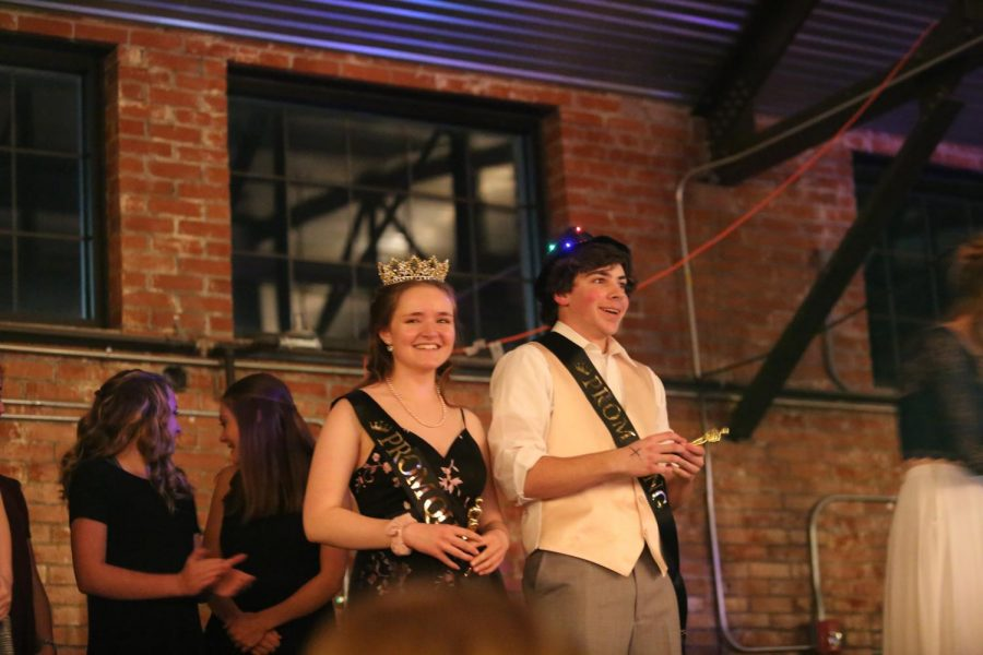 Enjoying+their+victories%3A%0AJulie+Jarrard+and+Garret+Clasen+stand+on+stage+right+after+being+crowned+prom+king+and+queen.+Both+were+very+excited+to+receive+these+titles.+The+crowd+was+also+excited+for+these+two+and+cheers+were+heard+all+throughout+the+Hangar+where+NC+Prom+2019+was+held+on+April+6th.