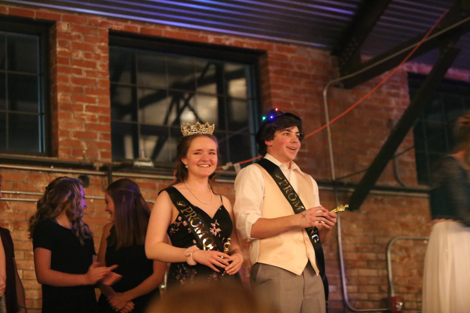 Enjoying their victories: Julie Jarrard and Garret Clasen stand on stage right after being crowned prom king and queen. Both were very excited to receive these titles. The crowd was also excited for these two and cheers were heard all throughout the Hangar where NC Prom 2019 was held on April 6th.
