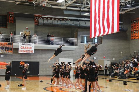 NC cheerleaders perform for Oil Bowl Pep Assembly.