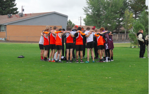 Sportsmanship among teams: The mustang cross country team includes runners from Torrington in their cheer before the JV boys' race on September 27, 2019. The cheer is led by senior Chris Finch. Finch said the mustangs had never met the runners from Torrington ever before, but they wanted to be included so the mustangs let them join the huddle.
