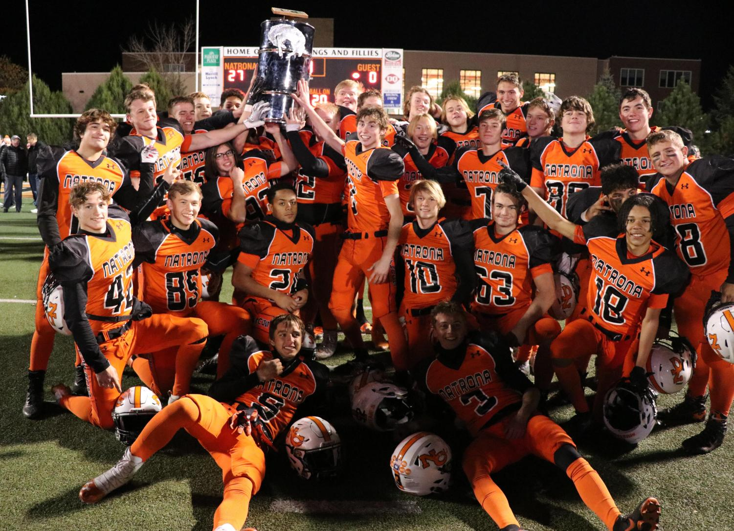 A symbol of victory: The NC mustangs hoist the Oil Bowl trophy after defeating the KW trojans 27-0. This is the mustangs' 42nd Oil Bowl win. The trophy will be on display at NC for the third year in a row.