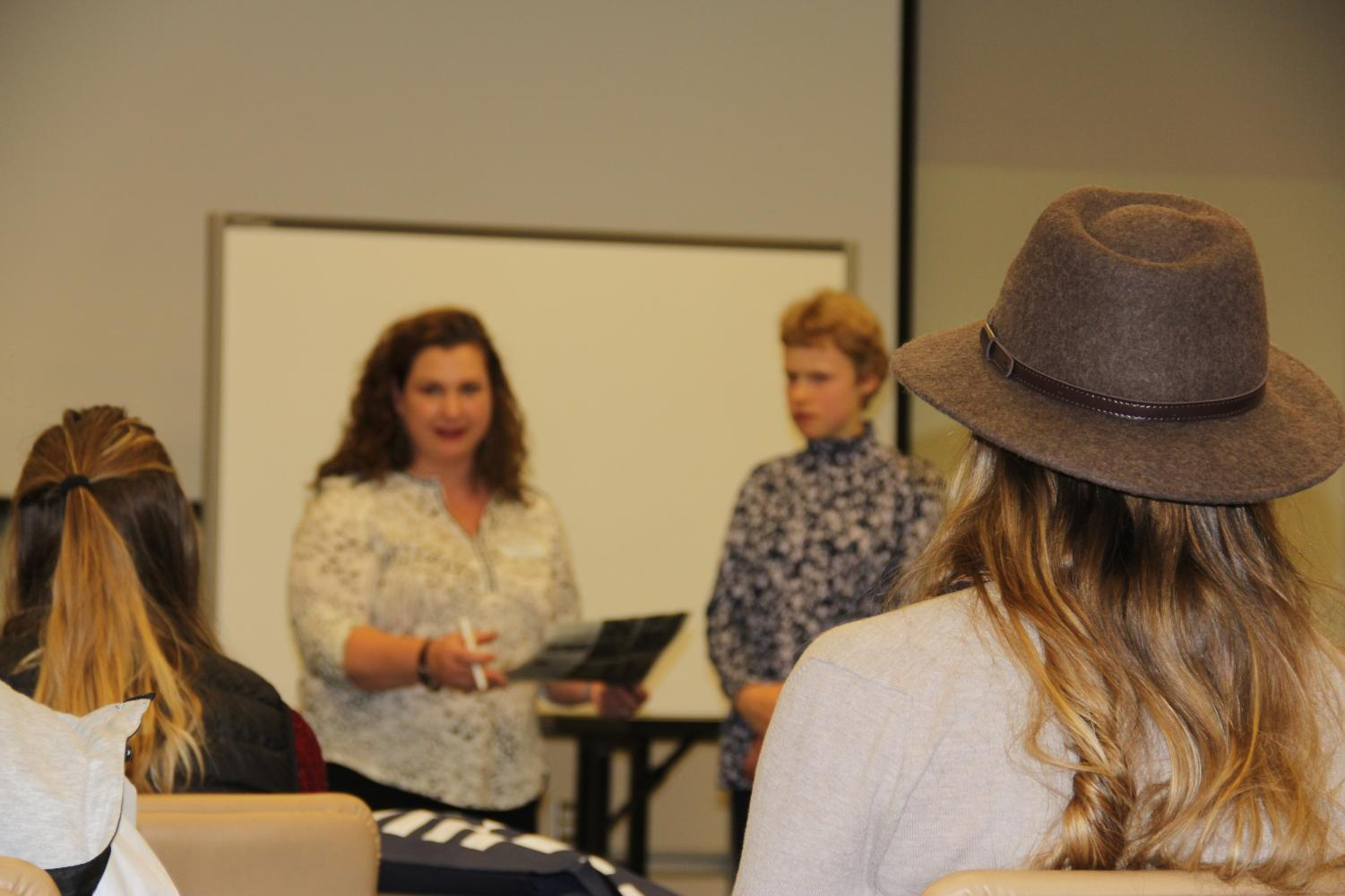 Jackson Hole News editor Joanna Love reviews students work at  the WHSSPA Journalism Convention. Students attended many workshops, such as