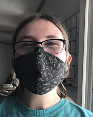 Maya Cooper models the mask she made to protect herself and her family during Covid-19.