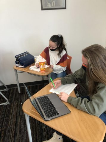 Two IB history students study for their IB history test.